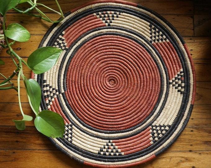 "Vintage Tribal Red Black Beige Flat Woven Straw Coil Basket - 14.75"""