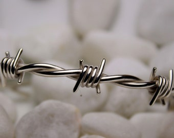 Barbed wire bracelet in sterling silver , wrist size 8.0/8.5 inches .
