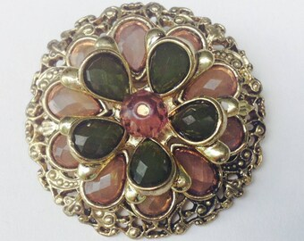 Gold Filligree brooch with pink and green stones