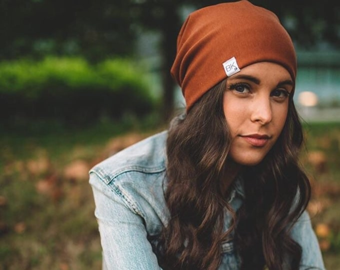 Featured listing image: Rust Bamboo Fleece Slouch Beanie- For every hat sold we donate one of our softest bamboo hats to a child fighting cancer