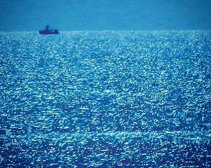 sparkly sea with boat