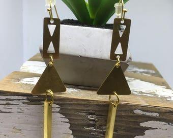 Modern geometric drop earrings in raw brass.