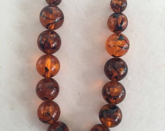 AmberVintage Plastic Beads on Gold Chain 23""
