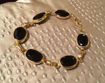 "Black 7"" Gold Tone Bracelet"