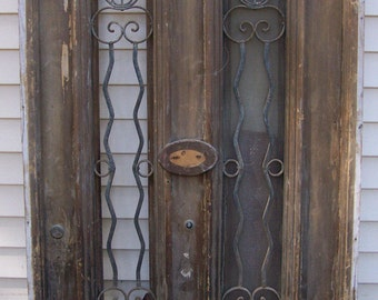 antique pediment windows with iron panels;salvage, iron window panel