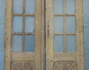 antique wood doors,curved glass panels,mediterranean salvage european doors,carved pine doors,architectural,tall wood door,old heavy doors