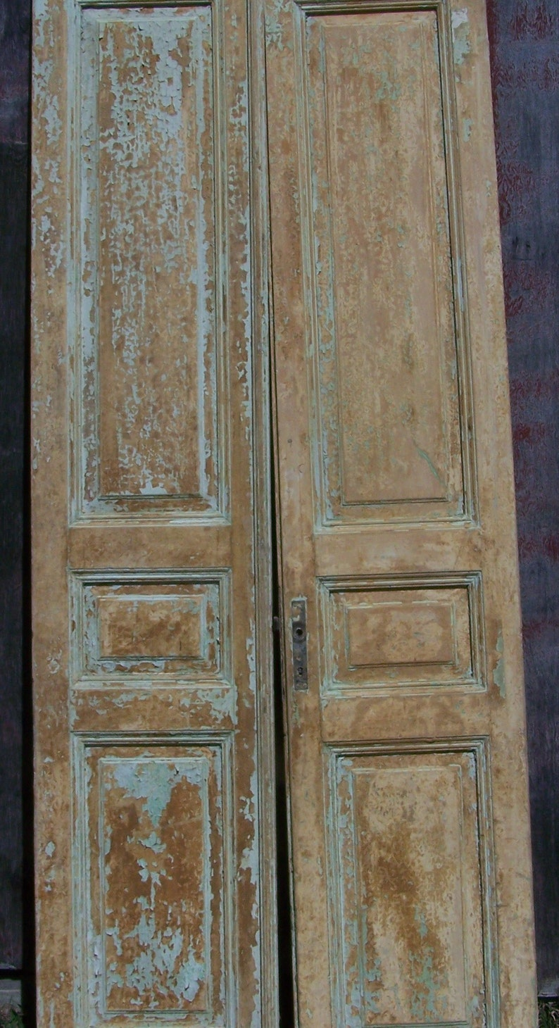 Rustic antique wood panel doors with peely paint