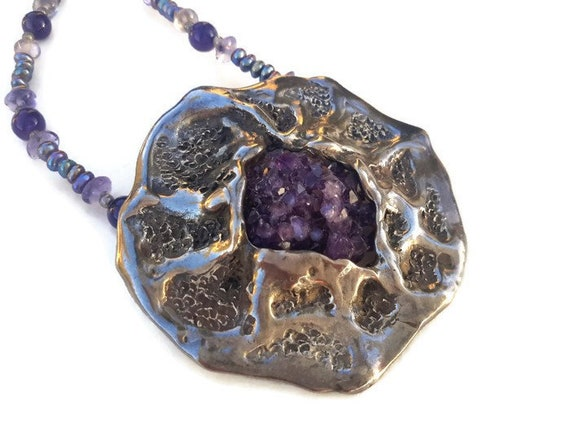 Handmade pendant necklace made from a light colored Banded Amethyst Cabochon