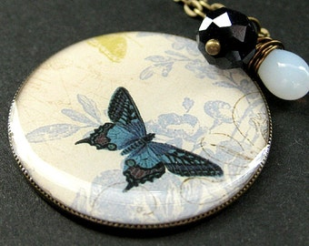 Cadet Blue Butterfly Necklace. Charm Necklace with Midnight Blue Crystal and Wire Wrapped Teardrop. Handmade Jewelry.