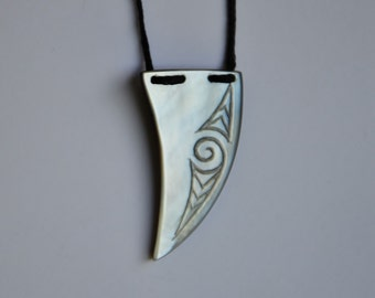 Tribal tusk or tooth pendant in Mother of pearl~with Maori engraving