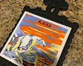 Vintage cast iron trivet with Alaska tile design ceramic center with polar bear picture