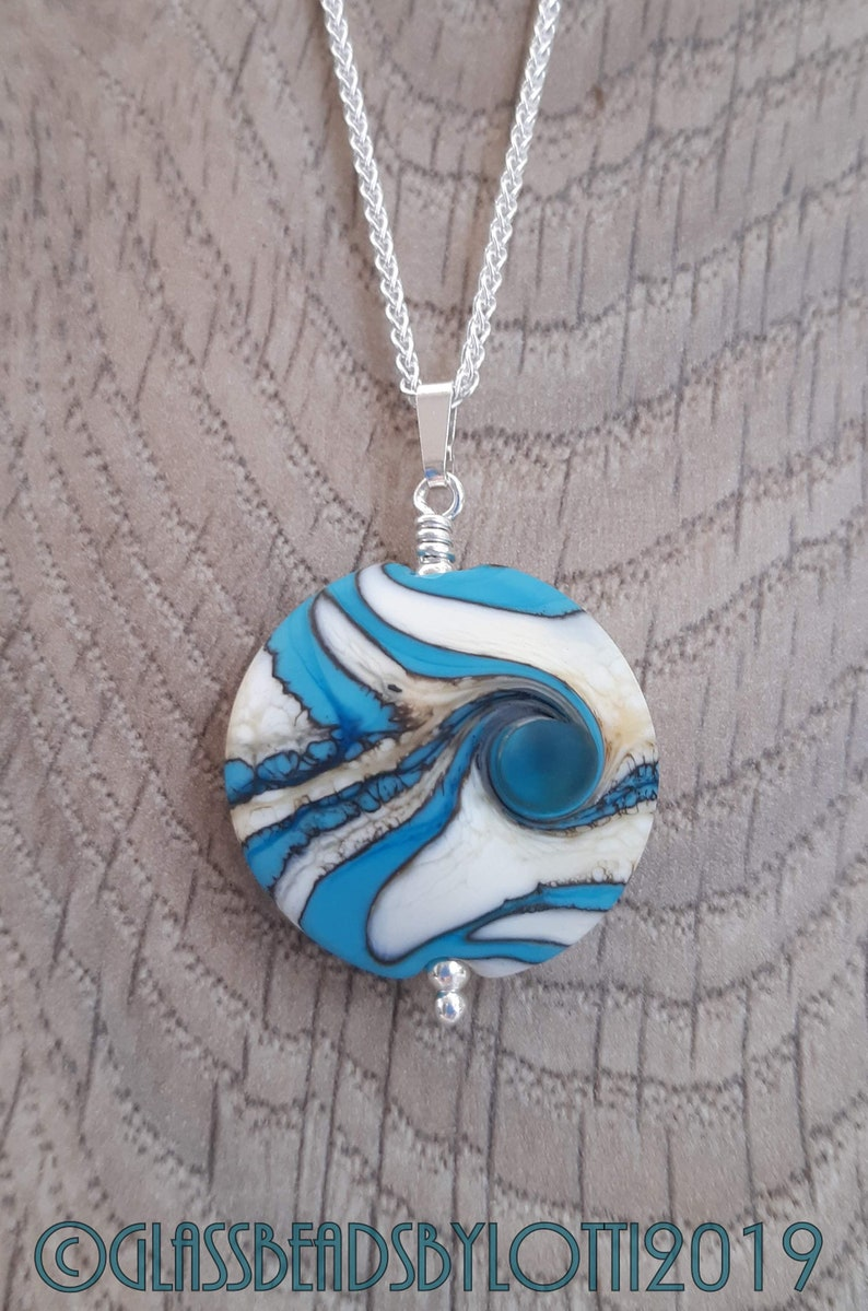 Opaque turquoise and ivory bead necklace on silver chain