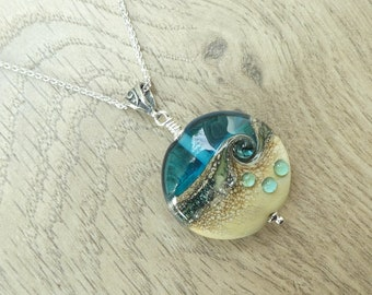 Transparent light turquoise and opaque ivory glass 'beach' bead necklace with dots on sterling silver chain