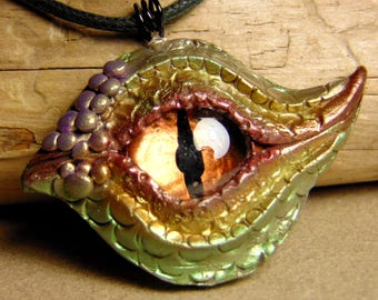 Polymer clay dragons eye pendant