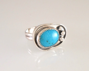Turquoise Sterling Silver Ring with Serrated Bezel and Ball Accents