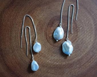 Baroque pearl earrings. White pearl threader earring. Threaded silver earrings with pearls. Lustrous pearl dangle earrings. Sterling silver.