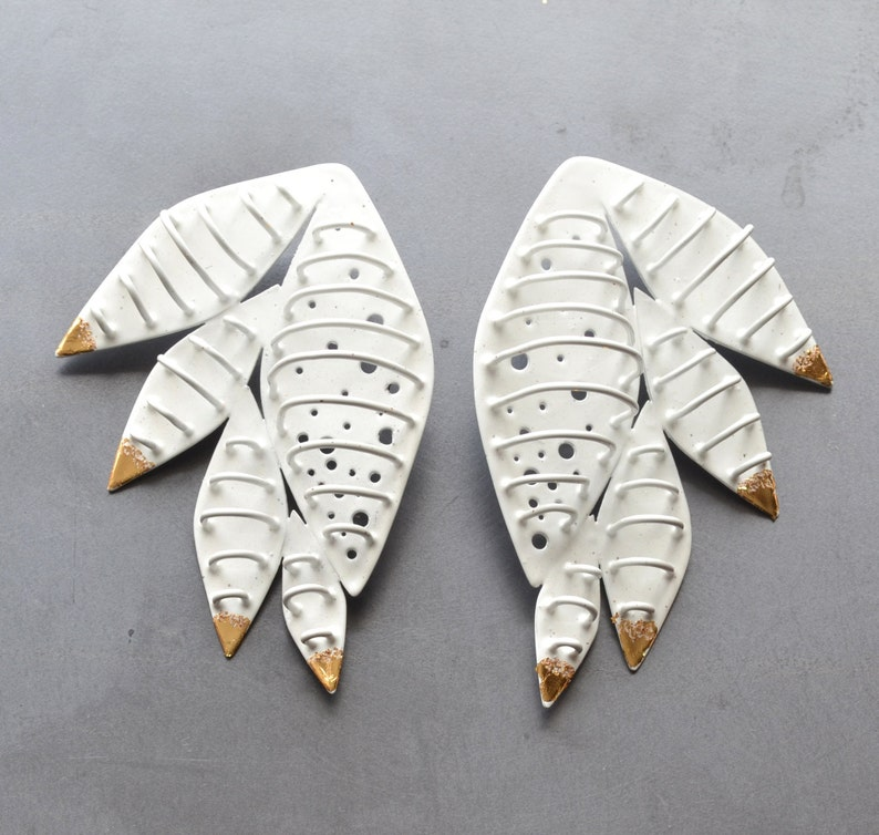 large cage earrings feather form gold leaf tips image 0