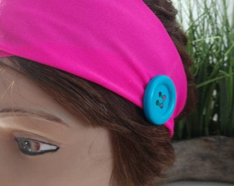 Hot pink headband with blue button