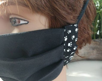 Black cotton Jersey face mask with interfacing with puppy paw prints