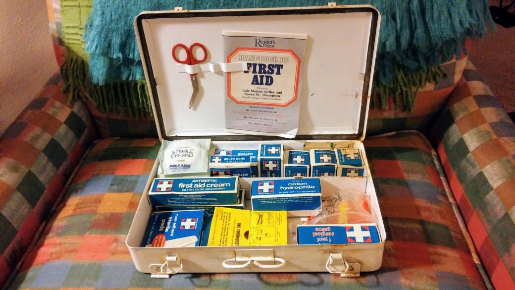 First Aid Kit 1970s Medical Supplies Readers Digest First Aid Booklet 1975  OSHA Gauze Bandage Scissors Eye Patch Full Metal Medical Kit