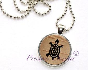 Turtle on birchbark pendant. Spiral turtle necklace. Turtle pendant.