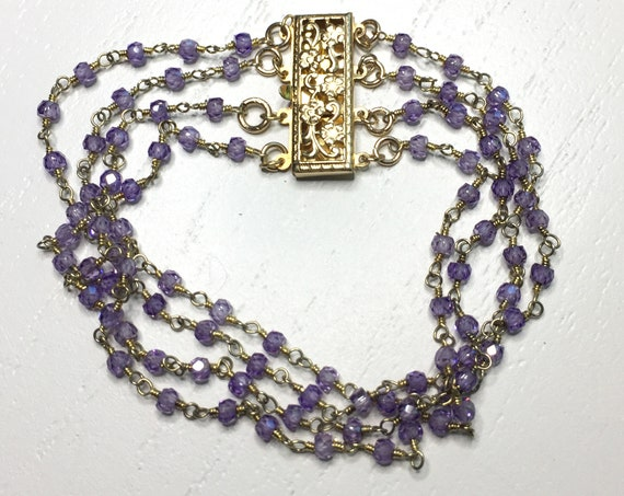 Four Strand Bracelet of Light Amethyst Cubic Zirconia (CZ) with 14k Gold Filled Filigree Clasp