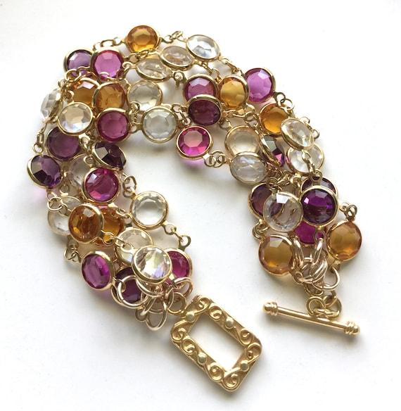 Sparkly Four-Strand Bracelet of Bezel Set Faceted Multi-Color Swarovski Crystals and a Gold Vermeil Toggle Clasp