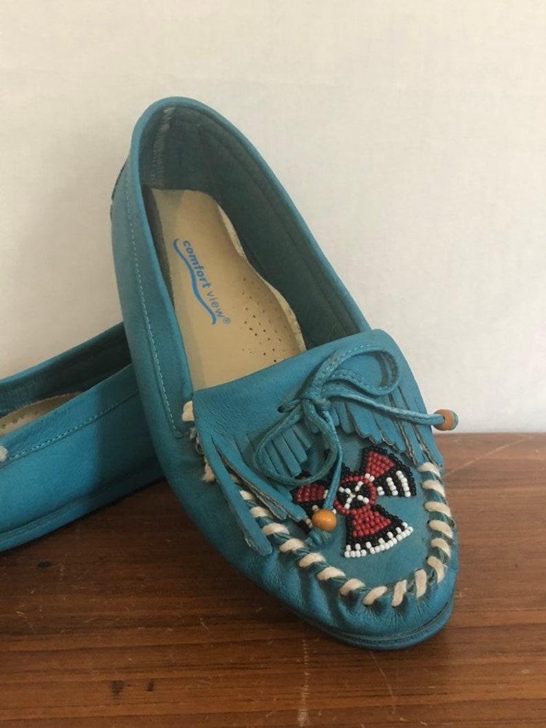 Vintage 70s Blue Fringe Moccasins w Beaded Thunderbird  Hippie Boho Southwestern Moccasin Shoes  Native American Festival Shoes