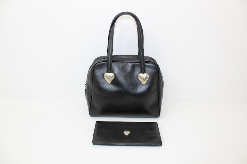 a74e18386625 Vintage 1980s Yves Saint Laurent YSL black leather handbag and