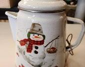 Vintage enamel coffee pot with snowman.