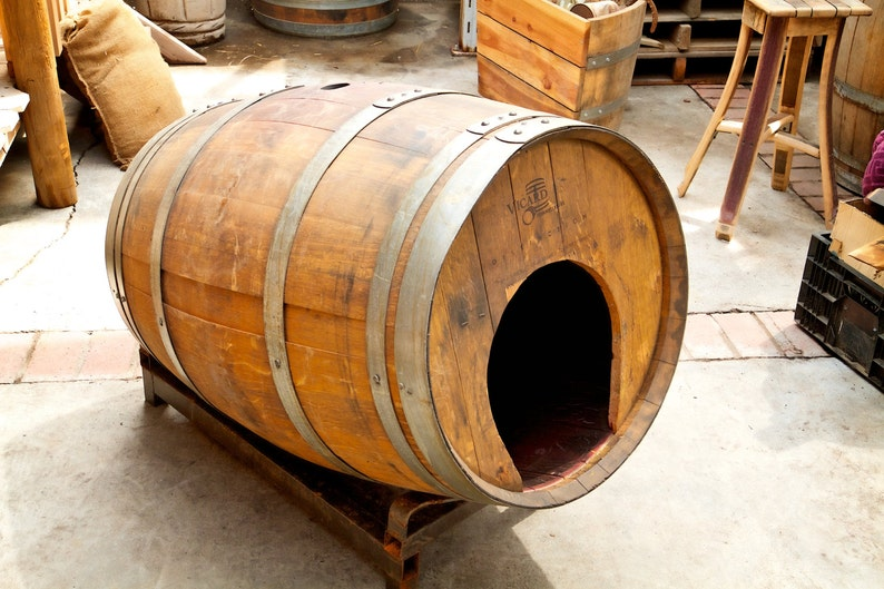 Rustic pet house made from a wine or whiskey barrel. Sits on a image 0