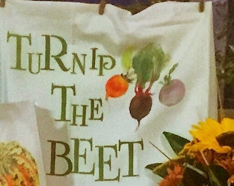 Hand painted tea towels with food puns