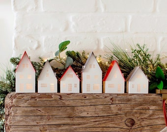 Modern Nordic Christmas village: holiday mantel decorations handcrafted of beautiful archival papers, folds for storage