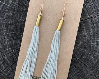 Silvery bunka cord fringe earrings with 22 caliber shells and handmade earwires