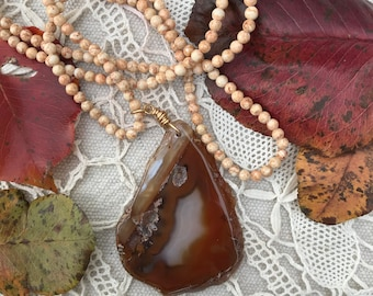 Shades of Sienna geode agate slice pendant on 32 inch vintage bead necklace