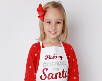 Kids Apron, Baking Cookies for Santa, white apron with red and silver glitter vinyl lettering, by Lil Miss Sweet Pea
