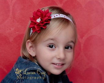 Valentine's Day red foil heart elastic headbands with rhinestone heart center on 3 inch flower by Lil Miss Sweet Pea