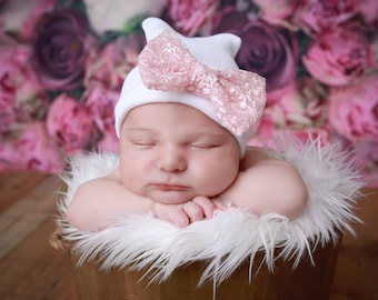 White Newborn Hospital Hat with a light pink lacey bow, baby hat, perfect baby shower gift, from Lil Miss Sweet Pea Boutique