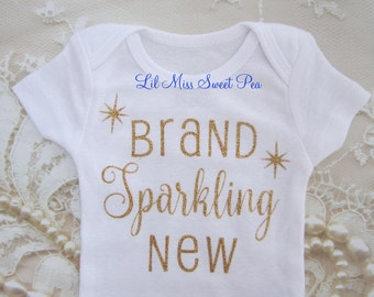 Welcome New Baby in Gold Glitter on White Outfit, Buy ONE for your favorite newborn, baby shower gift, newborn outfit, by Lil Miss Sweet Pea
