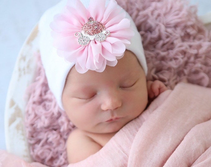 Featured listing image: Newborn Hospital Hat, for baby girl, white with a pink flower and princess carriage, infant hat, disney princess, bebe, Lil Miss Sweet Pea