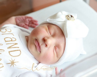 White Newborn Hospital Hat with a gold rhinestone button, baby hat, hospital hat, brand new baby, beanie from Lil Miss Sweet Pea Boutique