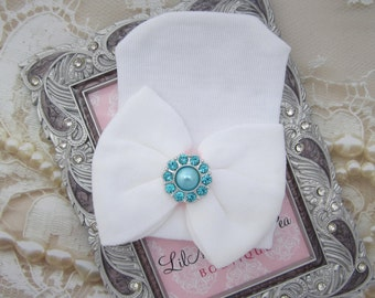 Newborn Hospital Hat, with a white with a silver and aqua rhinestone button, baby hat, from Lil Miss Sweet Pea Boutique