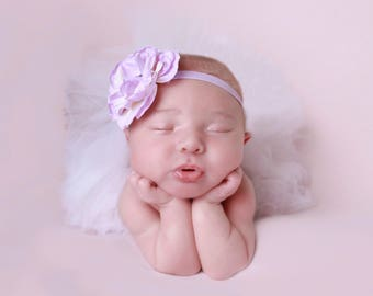 Lavender Rose with a Pearl and Rhinestone Center on skinny elastic. Perfect for all ages, newborn photos, Lil Miss Sweet Pea, Baby Headband