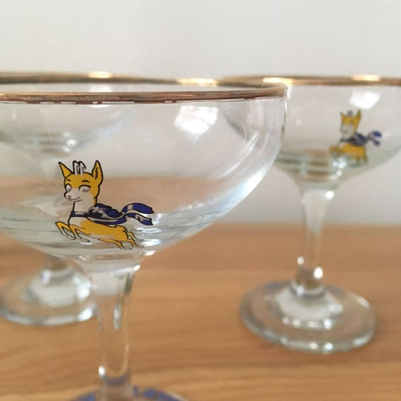 Two vintage babycham glasses