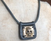 Bronze Skull Pendant on Leather