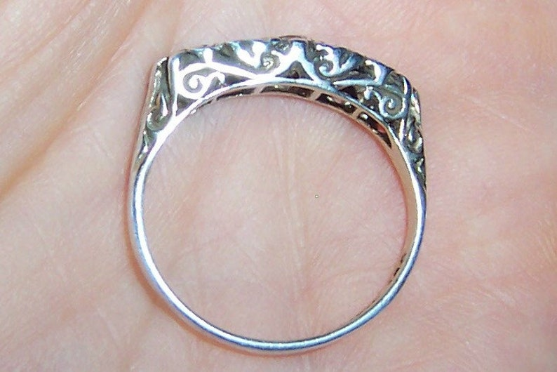 Sterling silver. 20/% OFF EVERYTHING Vintage Blue and Clear stones filigree ring