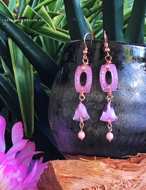 Swirled raw copper dangle drop earrings with pale pink glass drops and pale yellow green and pink glass beads and copper ear wires