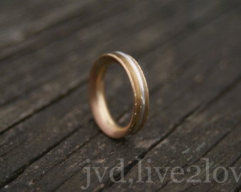 golden fidget ring with hammered silver spinner