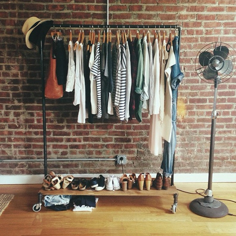 Industrial clothing rack with removable wood platforms image 0