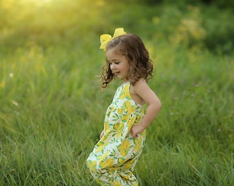 Lemon print  girls romper.   Available girls newborn to size 12.